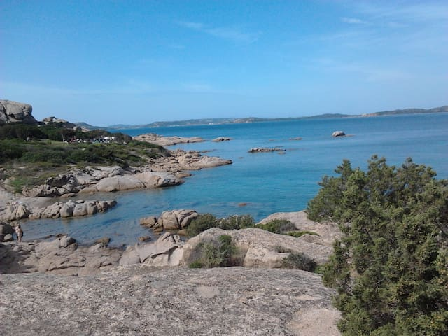 just 5 minutes walking, little beaches and granitic rocks.... just following the way near the Tennis Club
