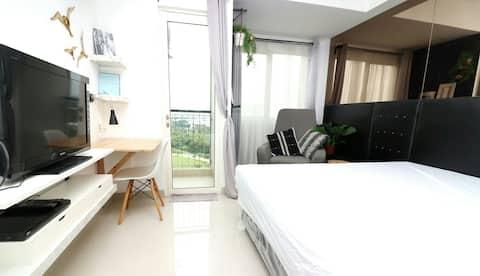 Suite Apartemen yang Hangat & Nyaman dengan tempat tidur ukuran king