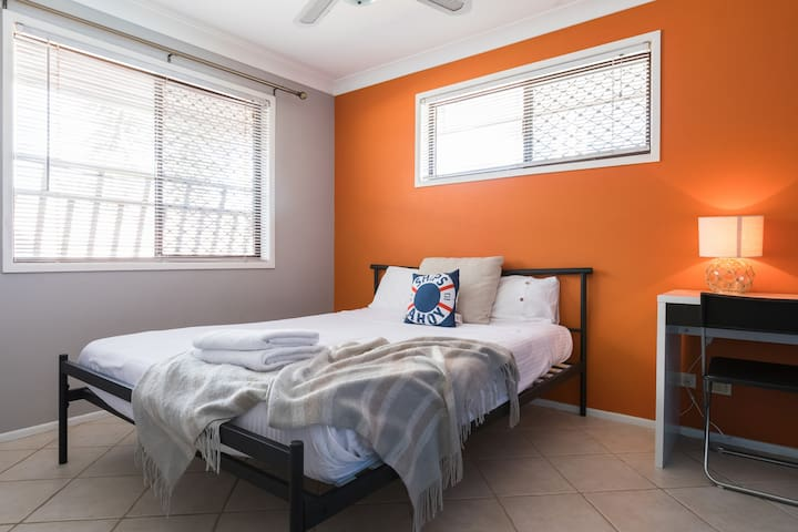 In the second bedroom, you'll find a comfortable double bed with a ceiling fan and wardrobe as well as a study desk creating a dedicated workspace.
