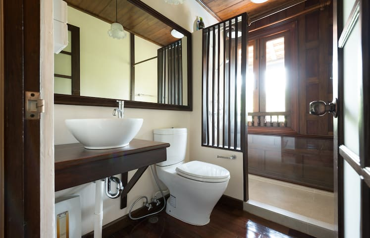 Shower and washroom with hot water.