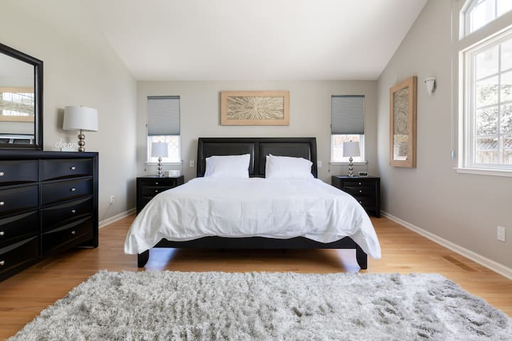 Spacious master bedroom with vaulted ceilings and a brand new King bed