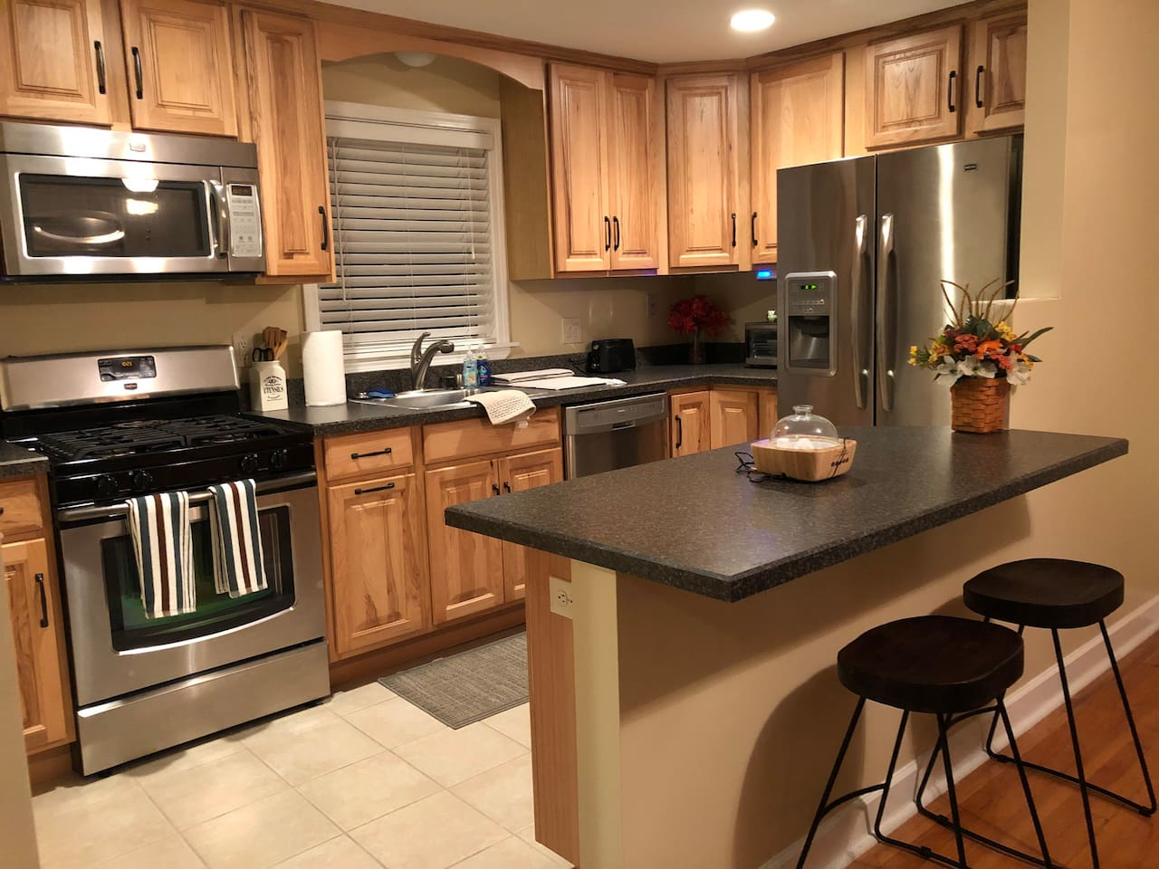Full kitchen with bar counter top