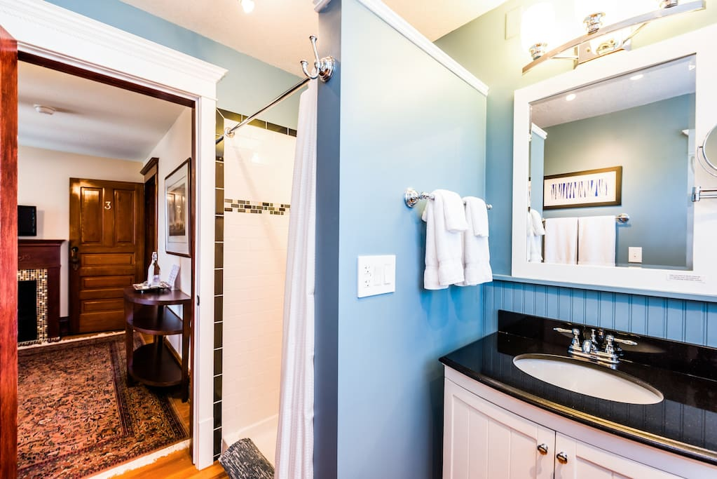 A private ensuite bathroom offers absorbent towels, make-up remover, magnifying mirror, hair dryer, shampoo, conditioner, soaps and other guest amenities.