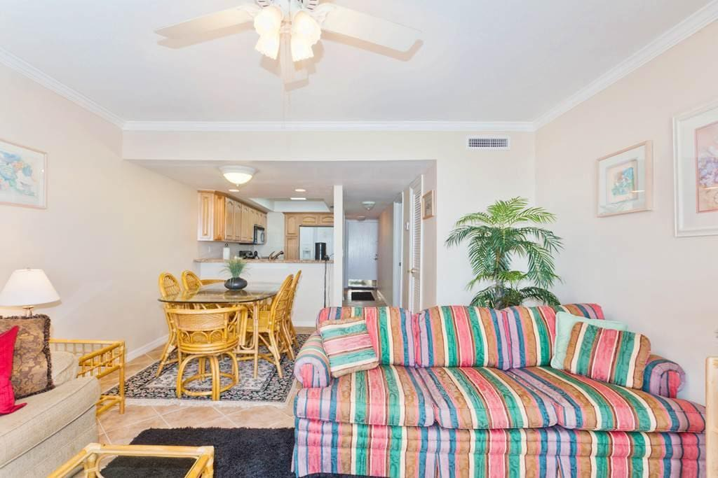 2nd floor living room with tile floors & ocean views - Our bright, sunny and beautifully furnished 2nd floor living room features
