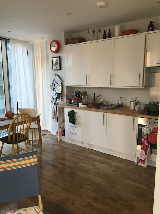 Kitchen/ living room. Kitchen table seats 6 comfortably, and kitchen is fully equipped with cutlery, pots, pans, basic herbs/spices and BOSE sound system that operates through WIFI
