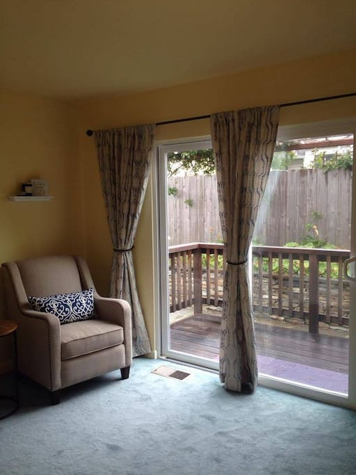 Sliding glass door leads to enclosed garden.
