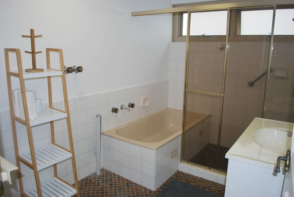Bathroom with full size bath and shower