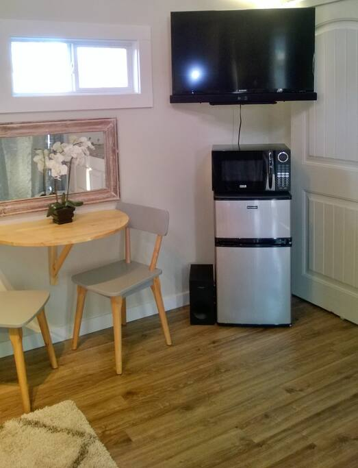 Flip through the cable, enjoy a cold beverage or heat up food in the tiny entertainment area.