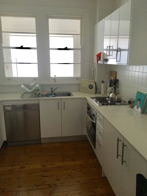 Seperate kitchen with great oven and cupboards stacked with everything you would need