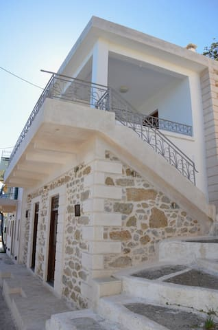 The stairs to the first-floor balcony and kitchen.