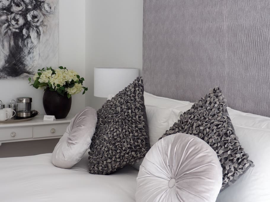 Crisp white pure cotton linen and soft down duvets and pillows for you to enjoy