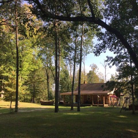 Storybook Little Manistee River log cabin