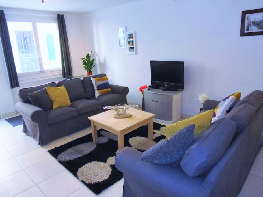 Bright lounge with comfortable sofas and UK FreeSat