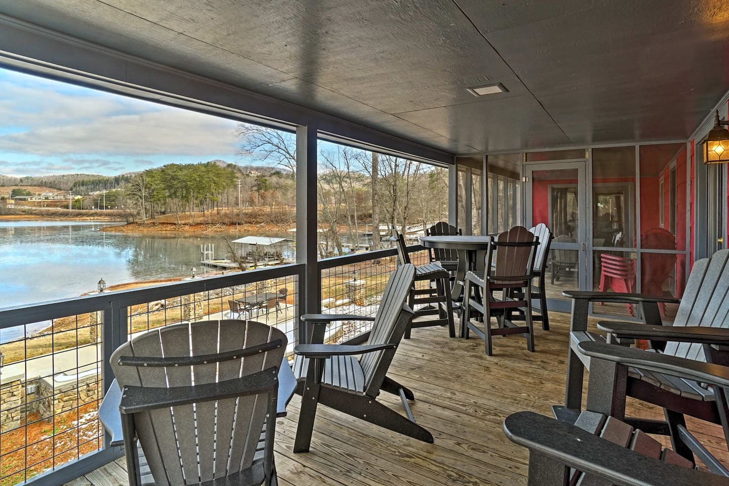 This property features a private dock, furnished deck, and hot tub!