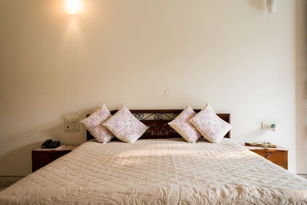 Clean comfortable inviting bed