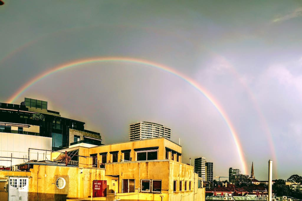 Spectacular double rainbow in soft sunset sun - the gift of Melbourne's crazy  weather