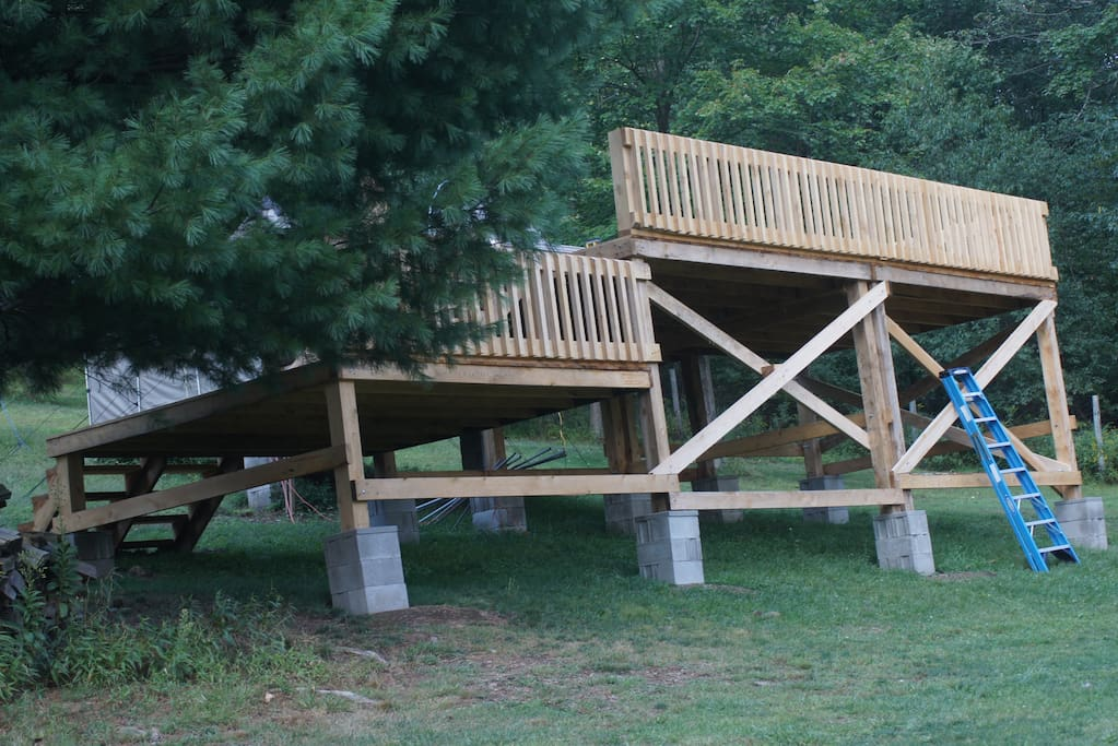 Two large decks,the top one has a canopy over it to provide shade or rain protection with a pic-nic table available