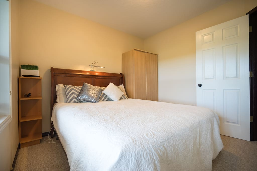 Bedroom with very comfortable and  clean queen bed.