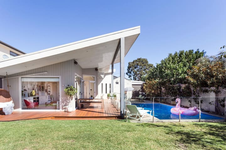 A mid century designed home in bayside Melbourne with a cantilever roof.  The home is carefully designed and appointed with mid century pieces and style.  The home boasts a large backyard with plenty of green space for friends and family to enjoy.