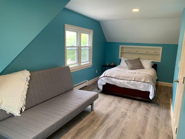 Large second floor bedroom w/ full bed, queen futon & A/C window unit.