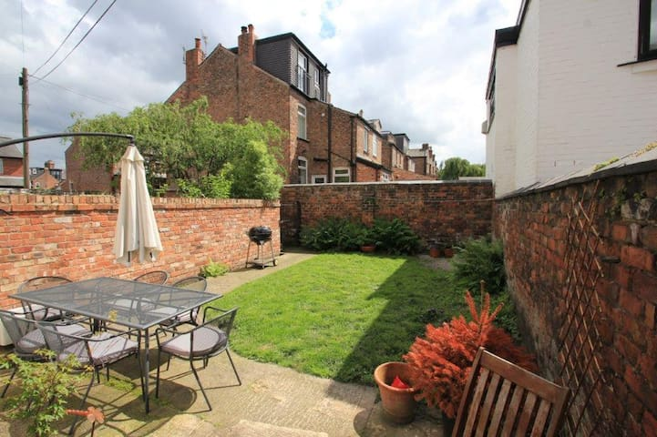 Sunny south-facing garden with BBQ