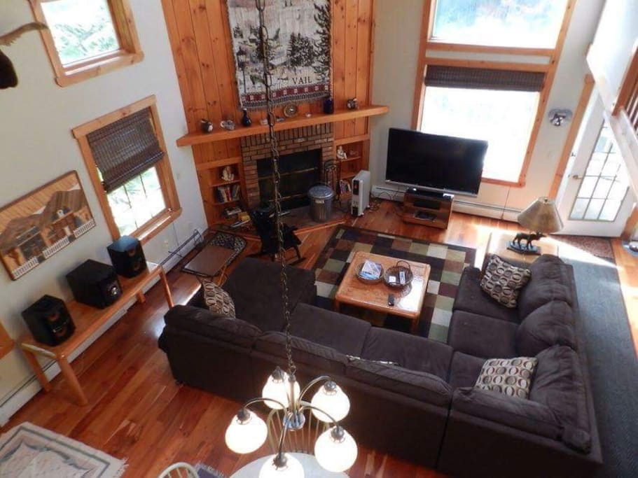 Main Family room of townhouse with 55 inch HDTV that has Free Netflix, stereo system that plays cds and Ipods, new furniture chairs,card table, elevated deck with outdoor furniture to lay out and relax and smoke out there if you like.