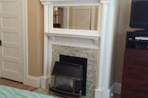 Original Edwardian detail. Gas fireplace heater.
