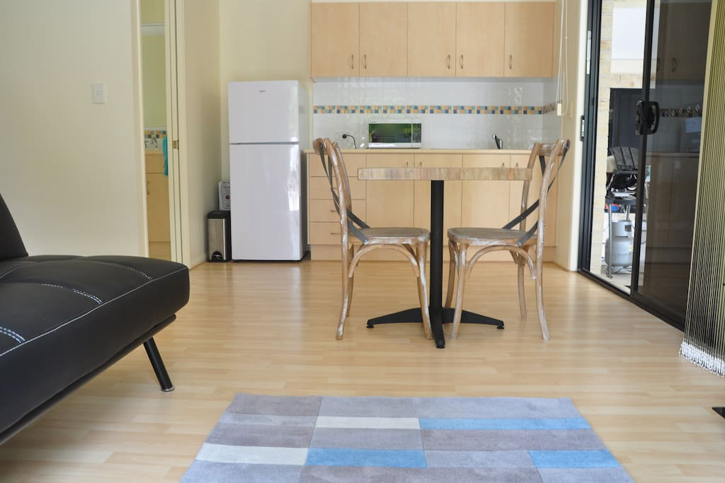 Studio unit with kitchenette, lounge, TV and queen size bed