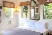 all rooms are bright with many windows and cross ventilation
