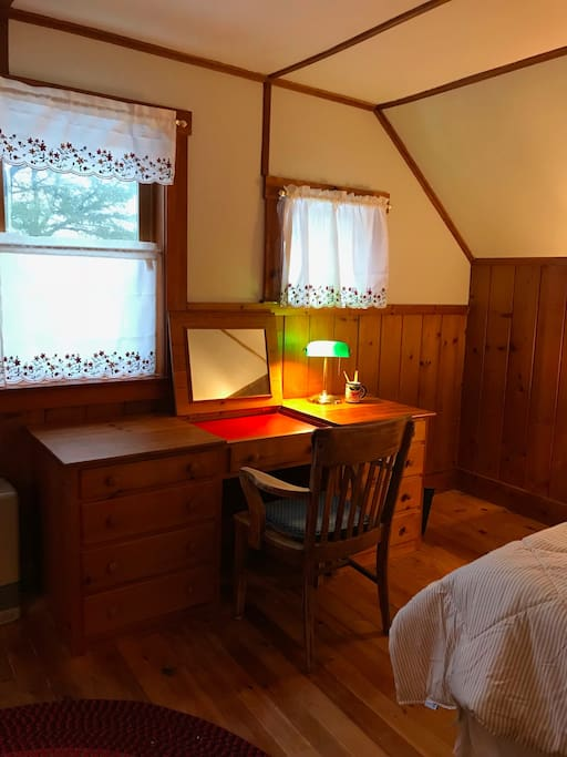Built-in desk faces the Damariscotta River. The desk-top opens up to a vanity mirror.