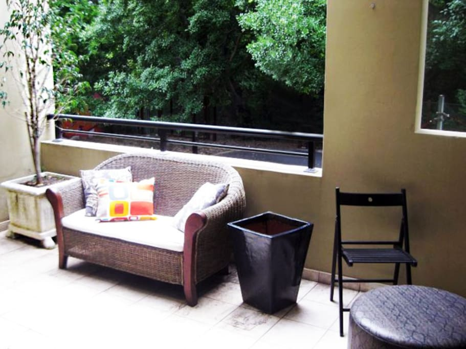 The main balcony overlooks beautiful fig trees, native birds and dogs playing in the park.