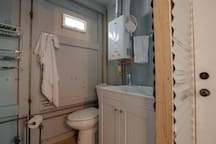 The guest shipping container toilet and sink area.