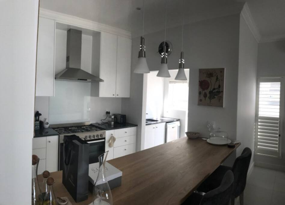 The open plan kitchen and breakfast bar