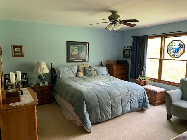 Large bedroom with a king size bed.  Brand new mattress set purchased in February of 2021.