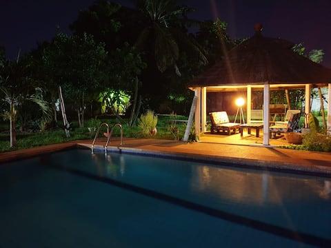 Chambre privée avec jardin et piscine