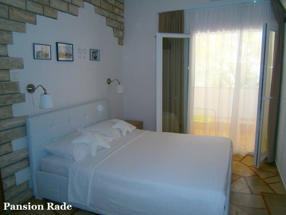 The room is equipped with new modern style queen size bed,