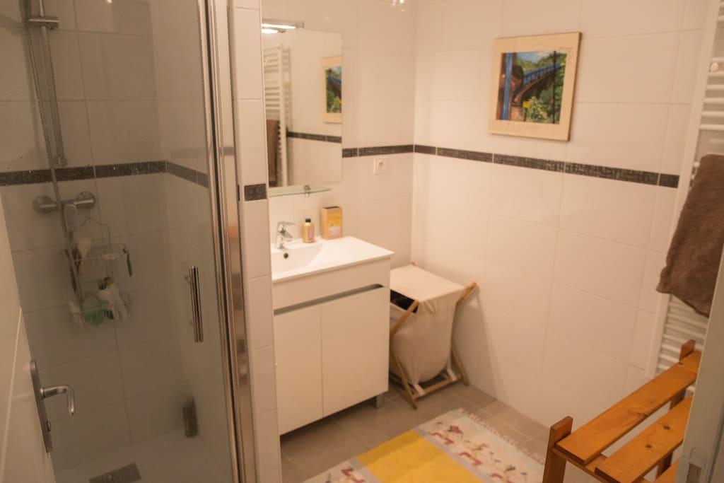Spacious bathroom, with toilet separate.