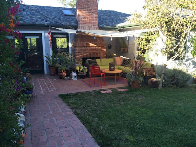 Entrance path to home. Enjoy the garden, drinks outside, and the seclusion of our home.