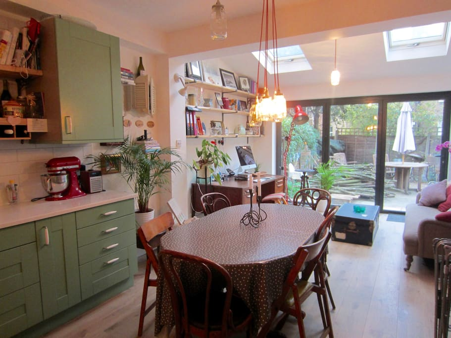 Bright and airy kitchen-dining room with direct access to a private garden