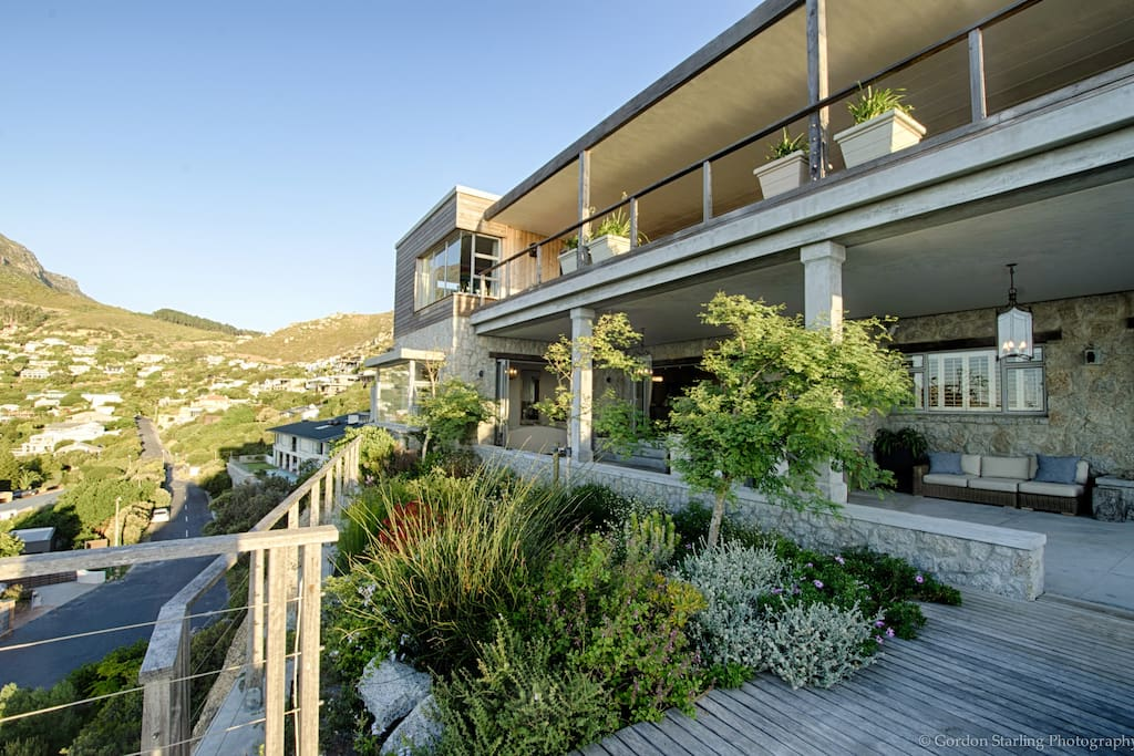Enjoy the best views in Llandudno, perched on a rock, overlooking the beach, the mountain, and Robben Island in the distance...