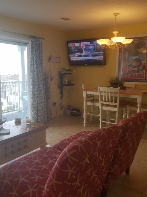 """dining area with 55"""" flat screen w/blue ray dvd"""