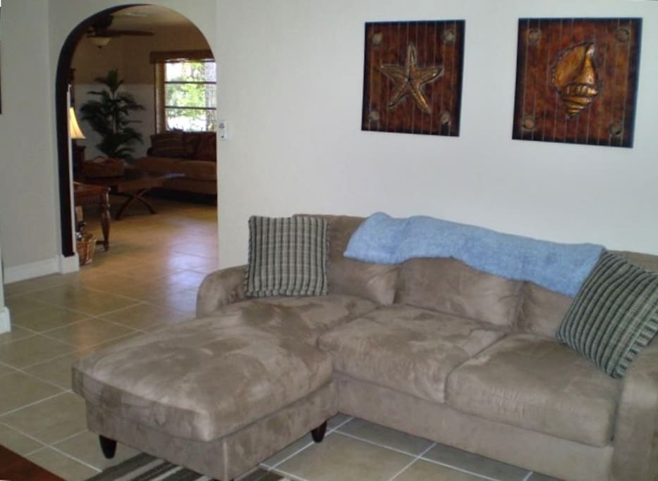 Game/lounge area--with a high-top table for 6.  Play games, have dinner or relax and read a book. Sofa opens up to Queen sleeper--very comfortable with all linens provided.