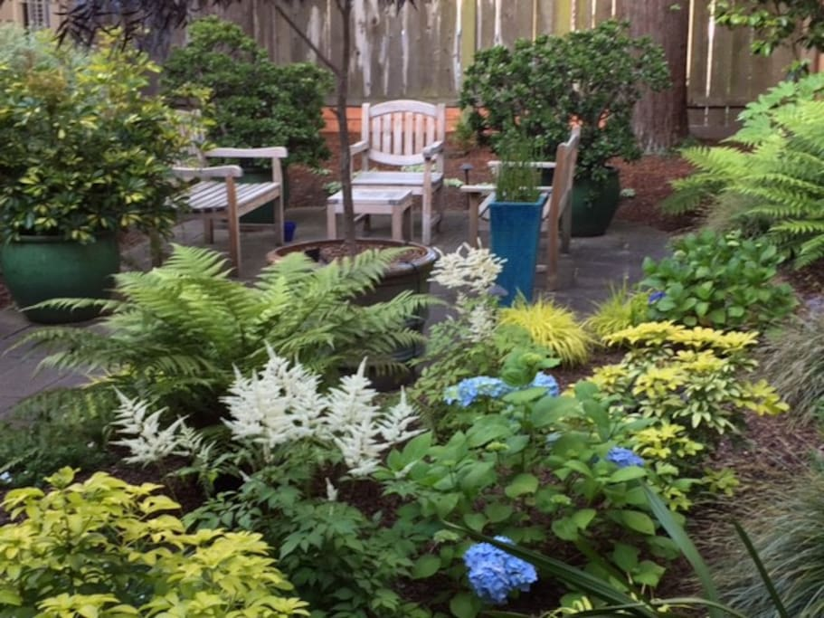 The garden has plenty of seating and is located just steps from the back door of the studio.