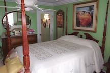 Guest bedroom 2 is beautifully decorated with a comfortable 4 poster queen bed. The artwork and decor are exquisitely and tastefully feminine.