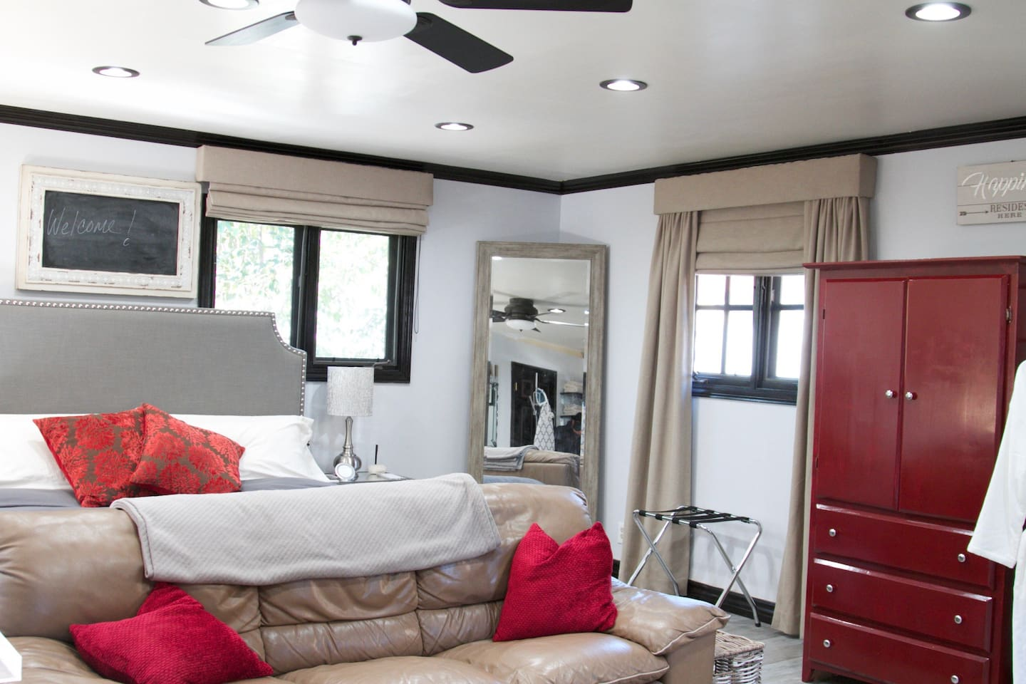 Air conditioning/Heating with Lots of Natural light plus overhead lighting, large mirror and armoire for clothing storage.