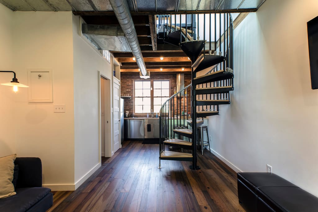 Living Room/Kitchen Level with Spiral Stairs to Master Bedroom