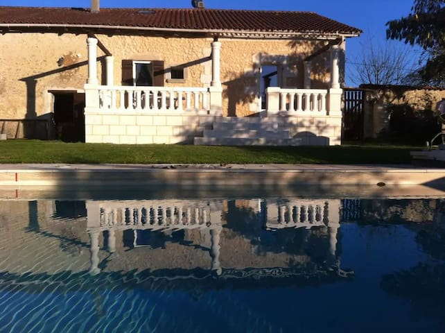Stone terrace overlooking the pool