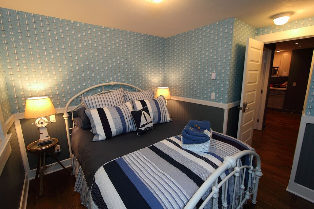Guest Suite Bedroom queen size bed adjoining private bathroom, flat screen TV/DVD combination dishnetwork HD channels.