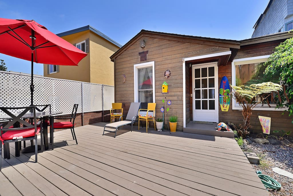 Large deck and front entrance to the home