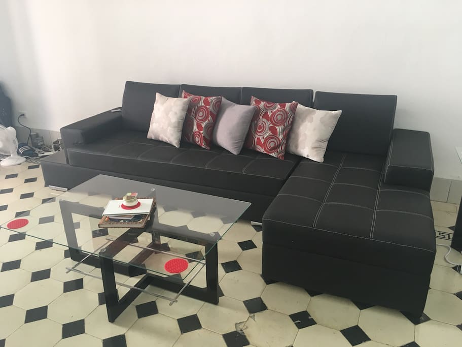 Leather couch and glass coffee table in Dining room
